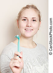 young beautiful girl with a razor