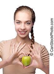 beautiful girl with an green apple