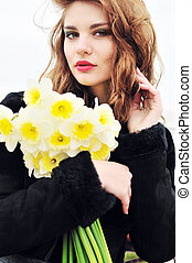 young beautiful girl with daffodils - young beautiful teen...