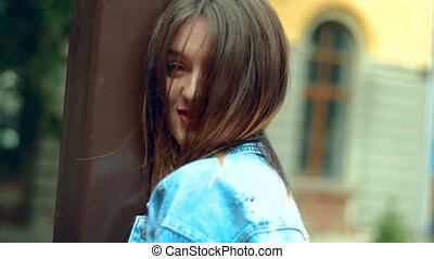 young beautiful girl with red lips walks and smiles on camera