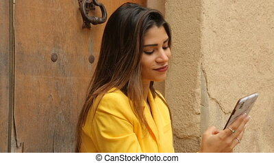 Young beautiful girl with smartphone