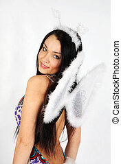 Young beautiful girl with white wings