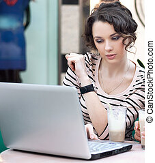 Young beautiful girl working on laptop