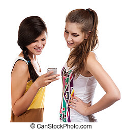 young beautiful girls using the cellphone to send and...