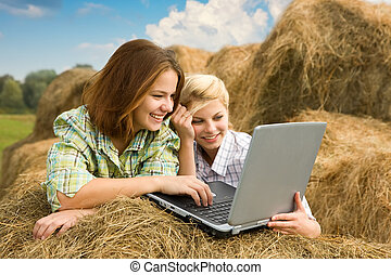 girls with notebook in farm - Young beautiful girls with ...