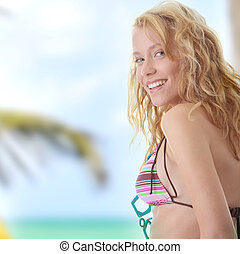 Young beautiful happy blond woman