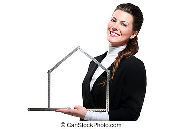 Young beautiful happy business woman house symbol