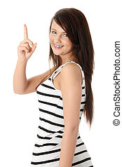 Young beautiful happy caucasian woman pointing up