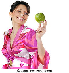 young beautiful happy woman holding green apple on white