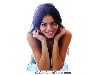 Young beautiful happy woman sitting isolated on a white background
