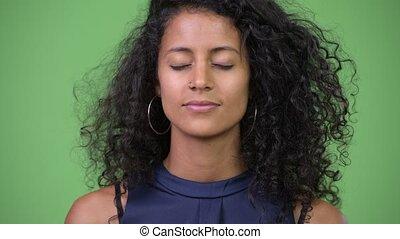 Young beautiful Hispanic businesswoman relaxing