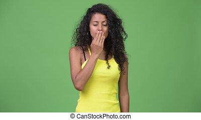Young beautiful Hispanic woman looking guilty - Studio shot...