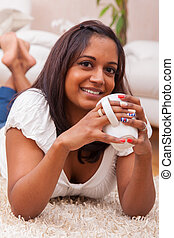 Young beautiful indian woman drinking coffee