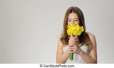 Young beautiful lady receive flowers and sneeze