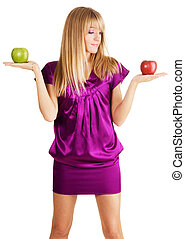 Young beautiful lady weighing two apples