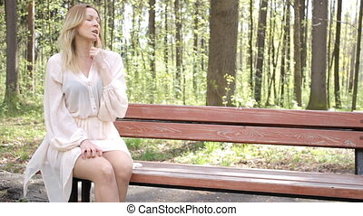 Young beautiful long-haired blonde in the summer on the...