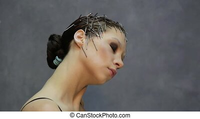 young beautiful model with unusual hairstyle posing for a photo in studio
