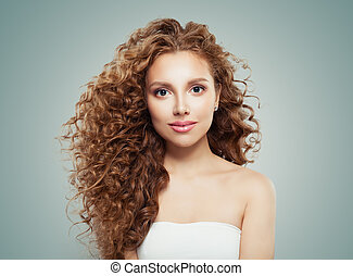 Young beautiful model woman with long healthy hairstyle on gray background