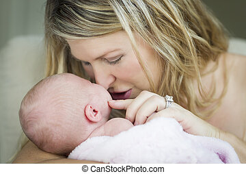 Young Beautiful Mother Holding Her Precious Newborn Baby Girl