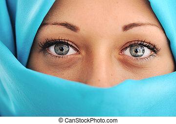 Young beautiful muslim woman in blue scarf