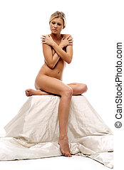 naked woman is posing in the studio