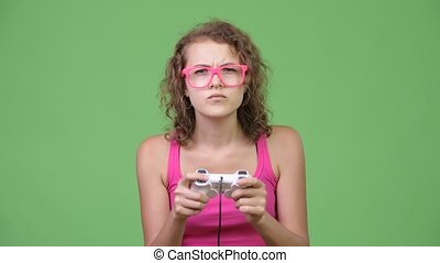 Young beautiful nerd woman focusing while playing games