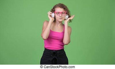 Young beautiful nerd woman listening to music