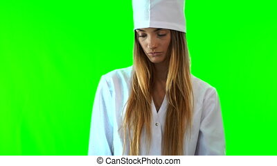 young beautiful nurse looking x-ray isolated on green...