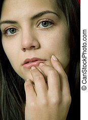 pensive - young beautiful pensive woman close up portrait