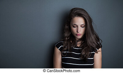 young beautiful pensive woman portrait studio