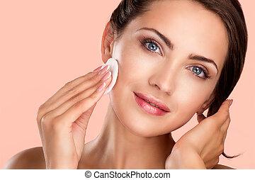 young beautiful perfect model applying professional makeup