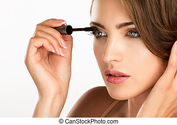 young beautiful perfect model applying professional mascara