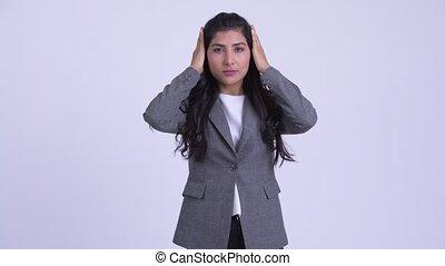 Young beautiful Persian businesswoman showing hear no evil...