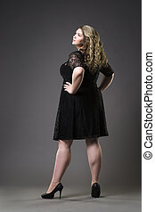 Young beautiful plus size model in black dres, xxl woman on...
