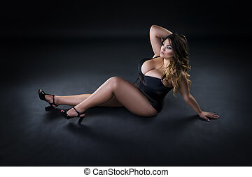 Young beautiful plus size model in underwear, xxl woman on...