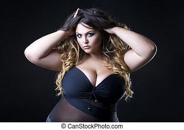 Young beautiful plus size model in underwear, xxl woman on...
