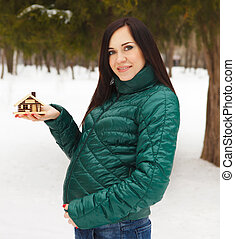Young beautiful pregnant woman in a winter day