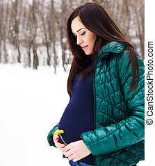 Young beautiful pregnant woman in winter