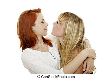 young beautiful red and blond haired girls try to kiss