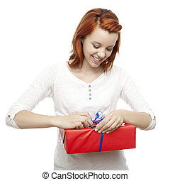 young beautiful red haired girl open present box
