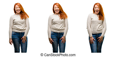 Young Beautiful redhead woman blinking eyes with happy gesture