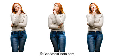 Young Beautiful redhead woman thinking and looking up expressing doubt and wonder