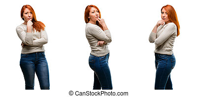 Young Beautiful redhead woman thinking thoughtful with smart face