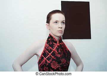Young beautiful redheaded woman