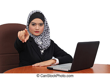 Young beautiful serious muslim business woman pointing on you