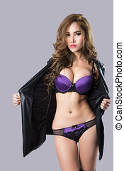 Young beautiful sexy Asian woman wearing elegant lingerie -...