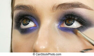 Young beautiful sexy girl models make blue evening make up...
