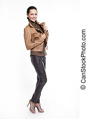 Young beautiful sexy smiling stylish woman in brown jacket isolated on white full length