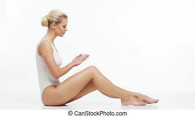 Young, beautiful, slim and healthy blond girl in white ...
