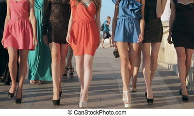 Young beautiful slim models walking on a city